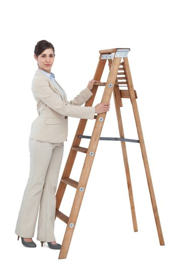 Young businesswoman at the bottom of the career ladder