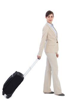 Businesswoman pulling suitcase