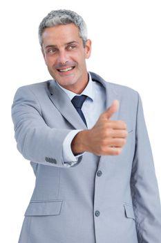Cheerful businessman reaching for handshake
