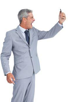 Furious businessman answering phone