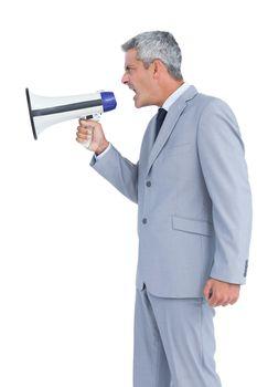 Businessman shouting in loudspeaker