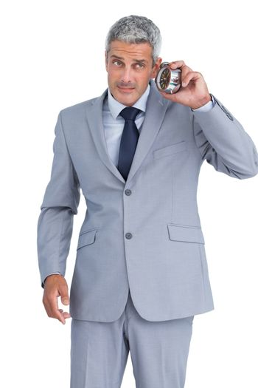Concerned businessman with alarm clock