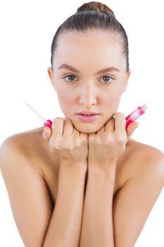 Model holding lip gloss