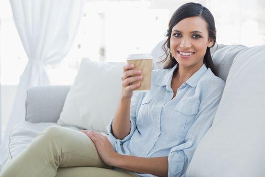 Happy seductive brunette having coffee