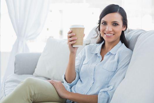 Cheerful seductive brunette having coffee