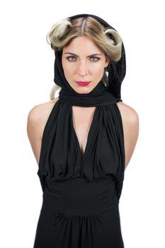 Serious creepy blonde wearing black clothes posing