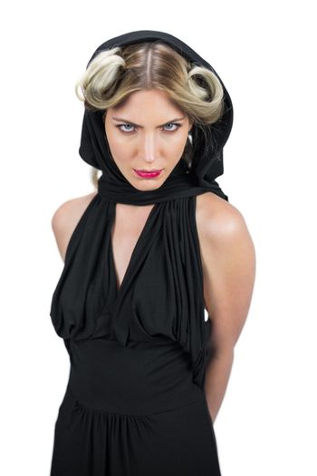 Frowning creepy blonde wearing black clothes posing