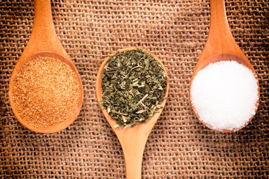 Spices in wooden spoon