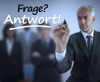 Businessman writing question and answer in german