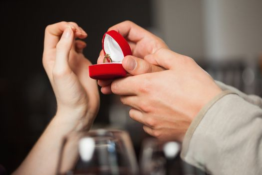 Close up on the ring during marriage proposal