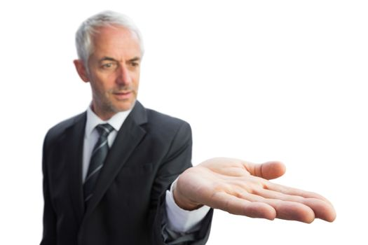 Concentrated businessman with palm up