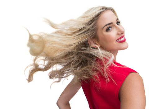 Blonde woman tossing her hair