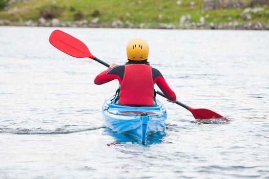 Woman rowing in a kayak