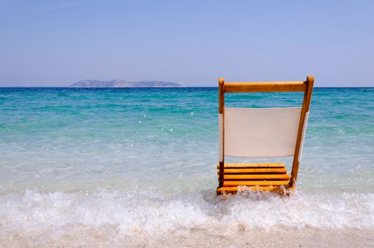 Single empty wooden chair on the beach