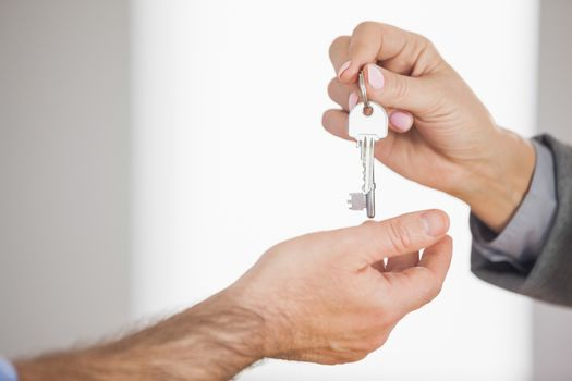 Estate agent giving key to customer