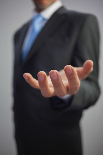 Close up of stylish businessman reaching out