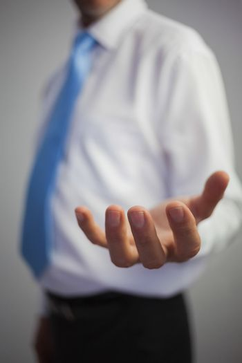 Close up of a casual businessman reaching out