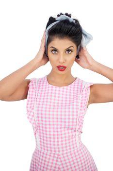 Serious black hair model styling her hair
