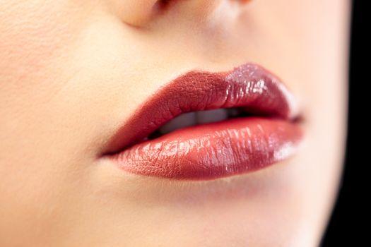 Close up on beautiful models glossy lips