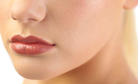 Close up on voluminous glossy lips