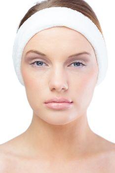 Serious blonde model wearing headband