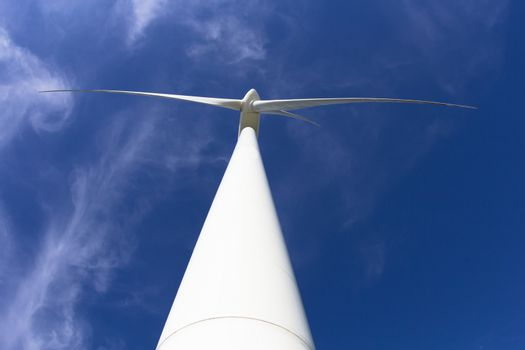 close up windmill power generator with blue sky