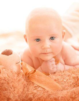 Newborn baby with soft toy