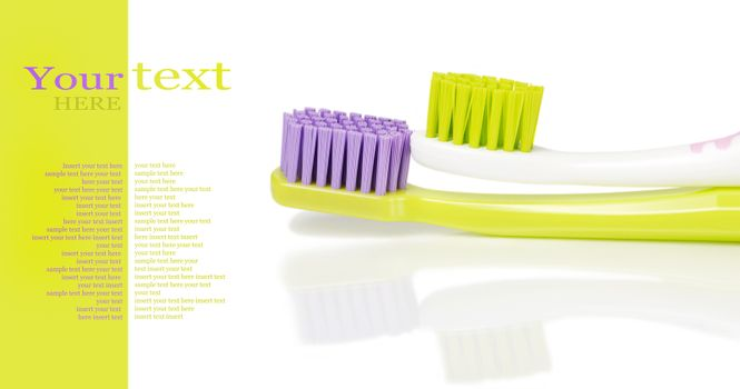 Two colored toothbrushes isolated on white with sample text