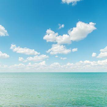 azure sea with blue cloudy sky