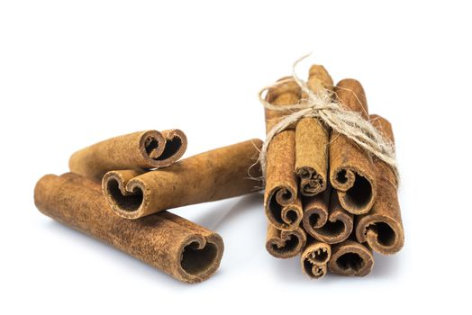 Cinnamon sticks isolated over a white background