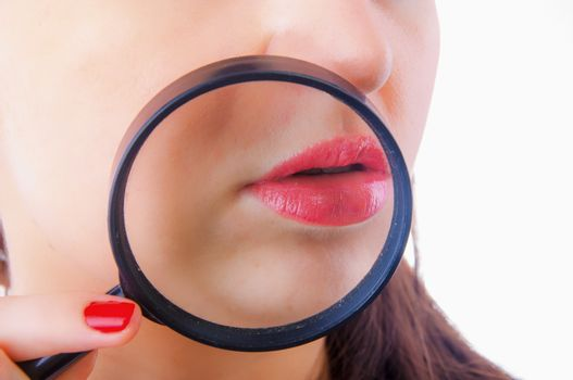 An image of Women with magnifying glass over her lips