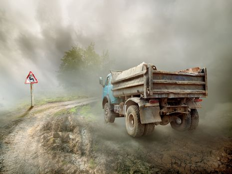 Dirty truck on a country road