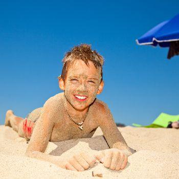 Sandy boy on a beach