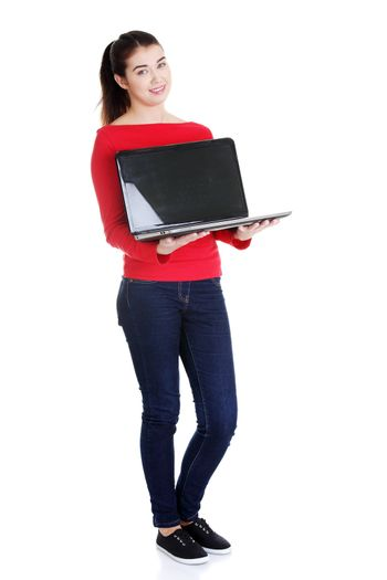 Woman holding 17 inch laptop