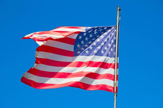 Flag of the United States against blue sky