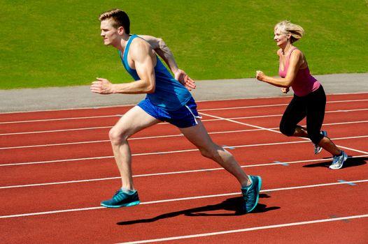 Athletes running on race track