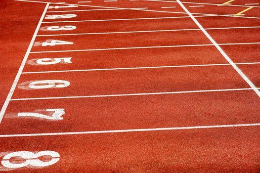 Eight runner tracks in a sport stadium