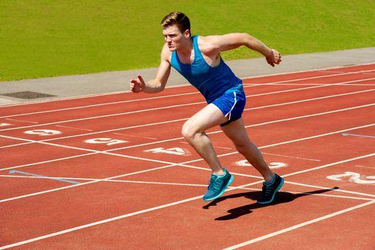 Male runner on starting blocks