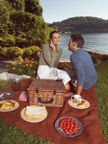 Happy peope together in a picnic outdoors