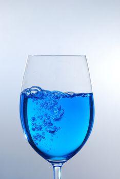 blue transparent liquid in wine glass