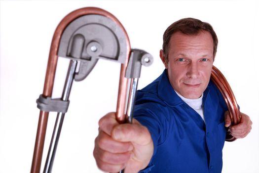 Plumber bending copper piping