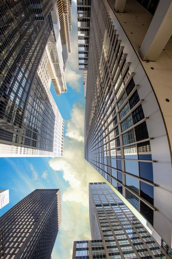 Tall and Giant New York City Skyscrapers, view from street level with gorgeous sky - USA