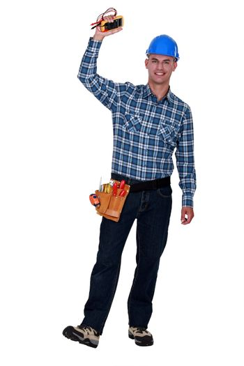 Happy electrician with multimeter in hand