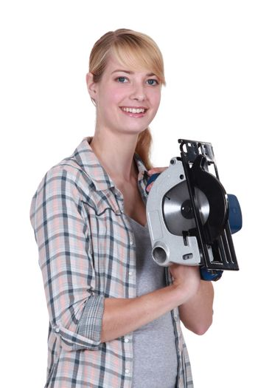 Woman with a circular saw