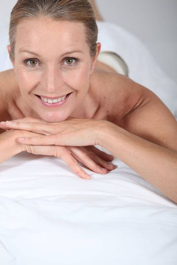 Blond woman laid on front awaiting massage