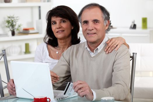 Married couple shopping on-line