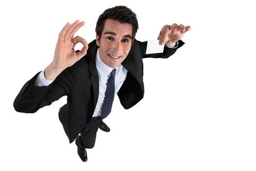 Businessman holding blank calling card