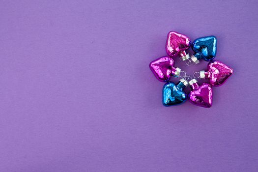 Purple background with christmas ornaments