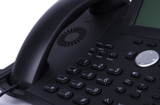 dark detail of modern telephone in horizontal view