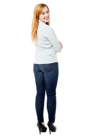 Attractive young woman turning back